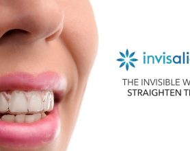 Smiling girl with Invisalign logo