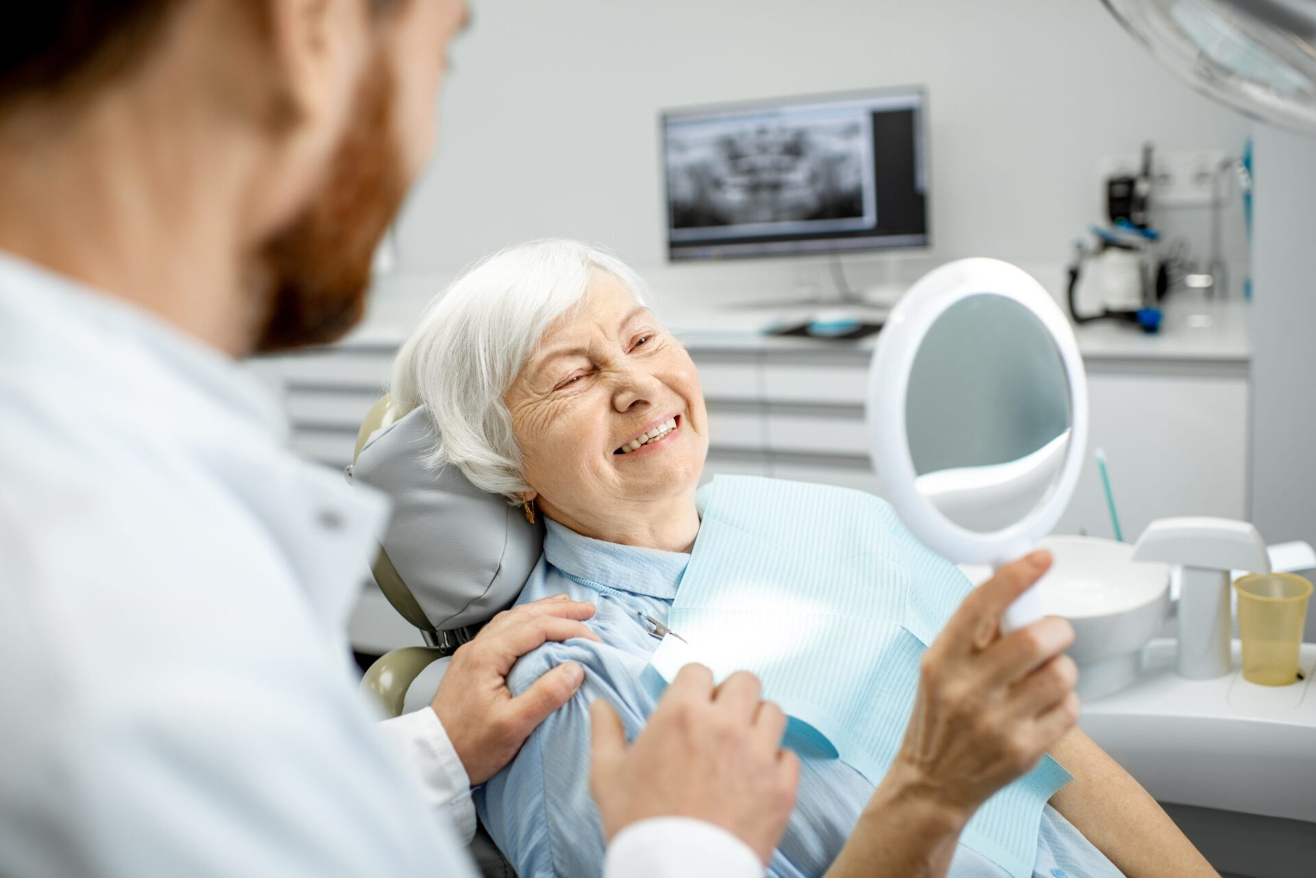 Aria Dental patient loving her new smile thanks to her new dentures
